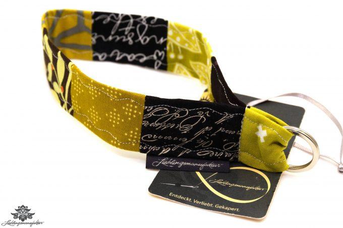 Kurzes Schlüsselband Farbe schwarz gelb