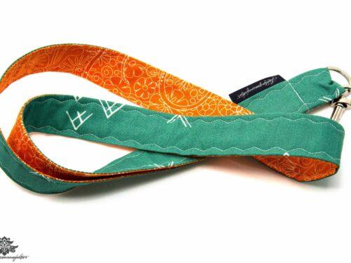 Schlüsselband moosgrün orange Blumen