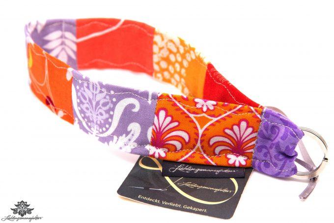 Schlüsselband Arm rot orange lila
